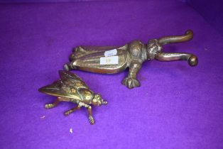 A vintage cast iron boot pull in the form of a beetle and a similar brass wasp box