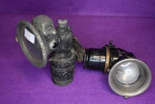 Two early 20th century bicycle or motor cycle carbide side lamps one marked Lucas and one marked