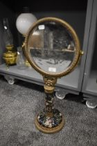 A Victorian style dressing table or shaving mirror having ormolu decoration with hand decorated
