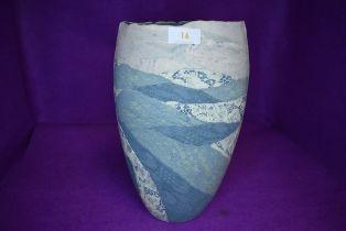 A studio pottery vase having green glaze decoration by Syl Macro ceramics Alston