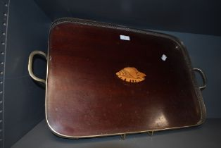 An early 20th century butlers tea tray having gallery sides with mahogany and inlayed platter