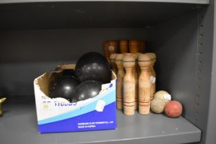 A set of Banda crown green bowls and similar wooden skittle sets