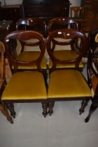 A set of four Victorian mahogany balloon back dining chairs on turned legs, later gold dralon