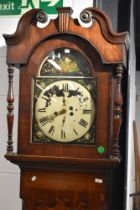 A 19th Century mahogany long case clock of large proportions having painted foliate dial, containing