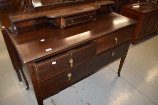An Edwardian mahogany dressing table having satinwood line inlay decoration