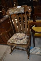 A traditional dark stained beech rocking chair