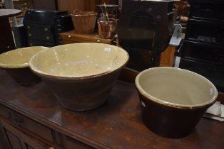 A set of three salt glazed dough bowls, various sizes