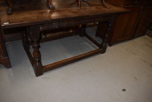 A traditional period oak refectory table having heavy triple plank top on turned legs, dimensions