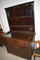 A traidtional period oak dresser, having delft back over double drawer base and single panel