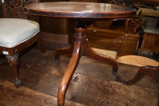 A 19th Century mahogany pedestal table, cut down height, having circular top over turned column
