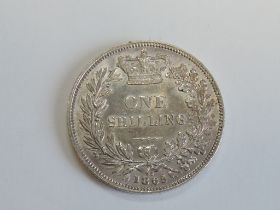 A Queen Victoria 1865 Silver Shilling, die number 92