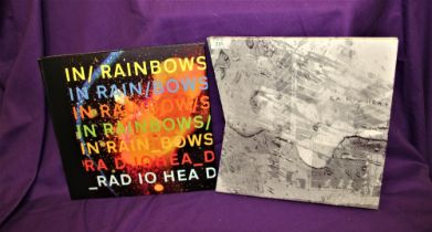 A box set of ' in rainbows ' by Radiohead - cd's and both vinyl records and in ex condition -