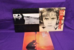 A lot of three albums by U2