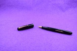 A Mabie Todd & Co Swan 3160 Self filler leverfill in black having a single narrow gold band to cap