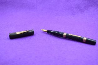 A Watermans Ideal Leverfill fountain pen in chased HBR, with band to top and bottom of barrel,