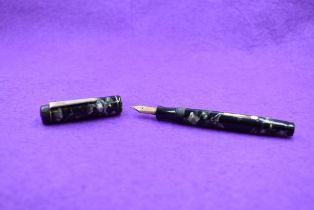 A Mentmore Auto Flow leverfill fountain pen in Green marble, single narrow band to cap with Mentmore