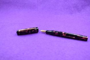 A Croxley 'the Croxley Pen' leverfill fountain pen in red marble with single narrow band to cap, a