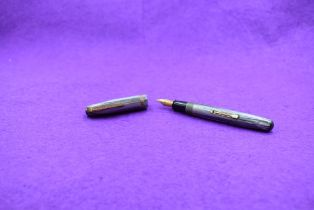 A Watermans 512V leverfill fountain pen in Grey stiated with single decorated band to cap and a