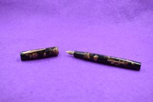 A Watermans Ideal leverfill fountain pen in black and brown marble with a single narrow band to cap,