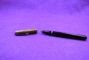 A Mentmore 46 button fill fountain pen in dark red, with silver cap . Approx 13.3cm. Silver rubber