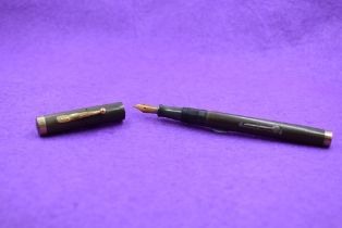 A Watermans Ideal Leverfill fountain pen in HBR, stamped 52 to bottom with 9ct .375 gold band to top