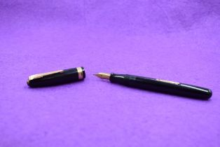 A Watermans 515 leverfill fountain pen in black with single broad band to cap, a Watermand 5 nib,