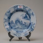 An English blue and white wear delft plate decorated in a Chinese style pattern depicting fantasy