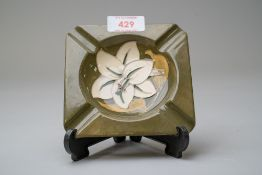 A ceramic ashtray by Moorcroft being stamped to reverse having a green glaze with the Bermuda