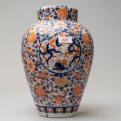 A large Imari palette ginger jar having lid with base having antique restoration 30cm high