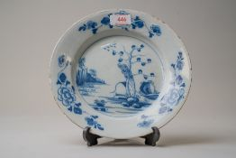 A late 18th century blue and white wear English delft plate decorated with a Chinoiserie style