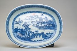 An antique hard paste Chinese export serving dish or charger having a hand decorated blue and
