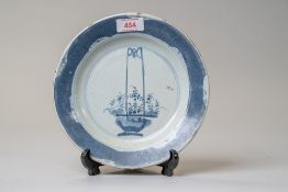 A Chinese or Japanese export plate in hard paste ceramic hand painted with flower basket scene and a