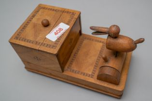A 20th century cigarette smokers mechanical dispenser having a light mahogany outer case with