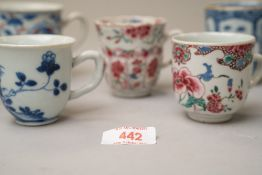 A selection of antique Chinese export hard paste tea or chocolate cups all being hand decorated in