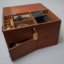 A vintage cine film projector 'the Kodascope' model c for 16mm film housed within a mahogany