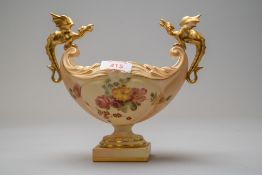 A Royal Worcester dragon boat or fruit bowl having a footed base with hand decorated floral work