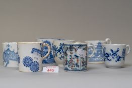 Seven blue and white wear antique tea or coffee cups in various designs including hard paste and
