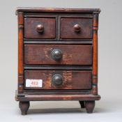 An apprentice piece of miniature furniture early 20th century of a chest of two over two drawers