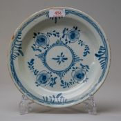 A late 18th century English delft plate or soup bowl in traditional blue and white design with