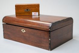 A Victorian jewellery case having rose wood case with ebony banding and a fitted interior in two