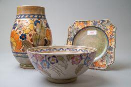 Three pieces of art deco design ceramics including an Arabesque bowl by Charlotte Rhead, a plate