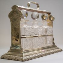 A fine silver plated tantalus by Walker and Hall of Sheffield numbered 16309 containing three cut