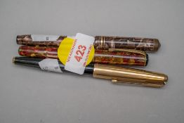 Three desktop fountain ink pens, one by Parker having metal cased cap, a Conway Stewart no.88 with