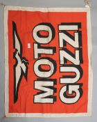 A vintage cloth advertising banner or flag for Moto guzzi motorcycles, approx 34'x 28'.
