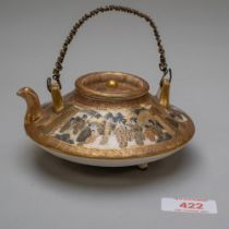 A Japanese saki or tea pot of squat form in a traditional Satsuma ware palette, highly decorated