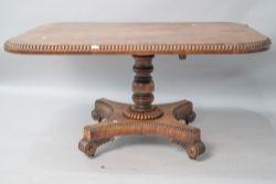 A William IV mahogany breakfast table having beaded edge, on snap hinge, turned column , platform
