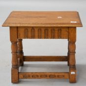 A golden oak refectory style occasional table, in the Priory style, approx. 48 x 30cm, height 43cm