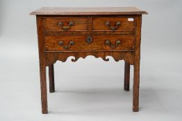 A 19th Century mahogany lowboy having two short over one long drawer, shaped apron and square