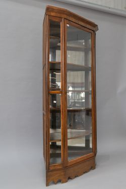 A late 19th or early 20th Century walnut corner display, possibly a shop fitting, comprising full
