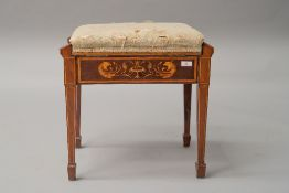 A Sheraton revival style mahogany piano stool having satinwood inlay decoration depicting mythical